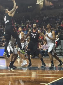 Rodney McGruder shoots the ball while Keith Benson blocks out