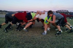 Siouxland United Wolves practicing a scrum.