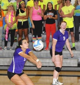 Dakota Valleys Shayla Johnson bumping the ball as Meredith Lammers watches