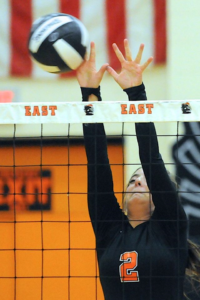 Sioux City East junior, Kennedy Franko, blocks the gall in Thursday nights contest.