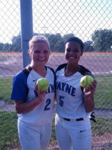 Taylor Gamble and Shannon Holdorf Gibson of Wayne holding their home run balls in their 2-1 win over highway 91. This win was the beginning of their 14 game win streak.