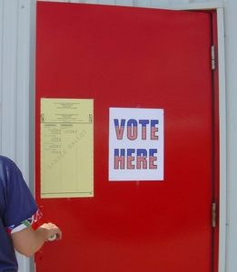 vote-here-woman-1436537